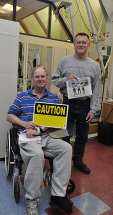 During their stroke recovery, Jeff Schmidt (left) and Tom Johnson played a light-hearted prank on their therapists to add humor to their Body Weight Support Treadmill therapy.